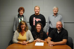 NPHS senior Carly Hackler signs her letter of commitment to Anderson University.