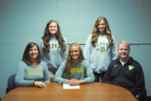 NPHS senior Natalie Kehrt signs her letter of commitment with DePauw University. With her are her parents, Jan and Brian Kehrt, and sisters Lindsey and Lauren Kehrt.