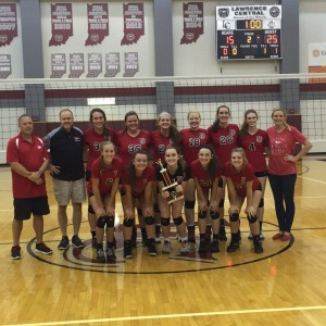 The New Palestine volleyball team celebrates the Lawrence Central Invitational title.