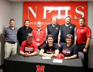 Keegan Watson signs his letter of intent to play baseball at Nebraska. With him are his parents and members of the NPHS baseball coaching staff.