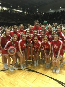 The New Palestine cheer team celebrates its second place in the coed varsity division.
