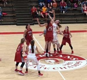 Katie Herron (25) goes up for the opening tip against Connersville.