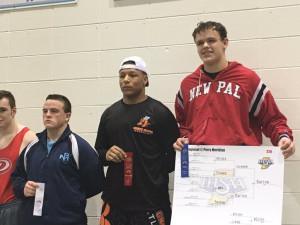 Junior Landan Burton celebrates his regional title at 220 pounds.
