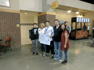 Alec White celebrates his state title with his family.