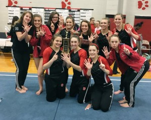 The Dragon gymnasts celebrate their sixth straight Rushville Invitational title.