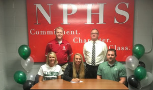 NPHS senior Raegan McMurray signs to play basketball at Illinois Wesleyan. With her are parents Rachael and Scott McMurray and (back row) NPHS coach Brian Kehrt and AD Allen Cooper.