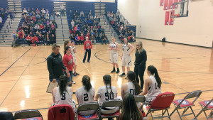 Sarah Gizzi (left) with her team prior to an eighth-grade game this season. A former standout player at NPHS, Gizzi was introduced to the Dragon players as their new varsity coach today. Photo by Jim Voelz.