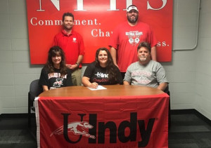 NPHS senior Lillie Cain signs to compete at the University of Indianapolis in track and field. With her are her parents and (back row) NPHS coaches Chuck Myers and Kyle Ralph.