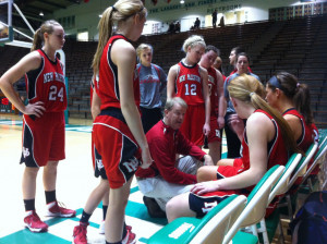 Brian Kehrt speaks to the Dragons during a game. His teams improved their record each season during his tenure.