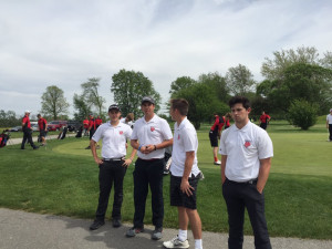 The New Palestine golf seniors are honored before their final home match.