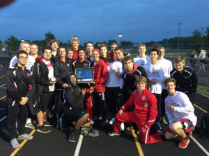 The Dragons celebrate the HHC boys track title.
