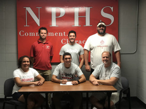 NPHS senior Brady Walden signs his letter of intent to compete in track and field at the University of Indianapolis. With him are his parents, Laura and Chris Walden and (back row) NPHS track coach Chuck Myers, brother Tyler Walden and NPHS track/football coach Kyle Ralph.