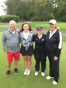 Seniors Regina Olsen and Mackenzi Black with NPHS coaches Gregg Greene and Sarah O'Brien.