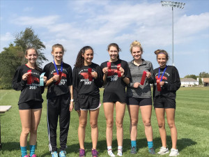 The New Palestine girls cross country team was second at Whiteland.