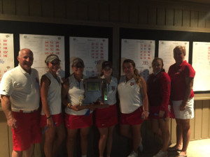 The New Palestine golf team celebrates its fourth straight sectional title.