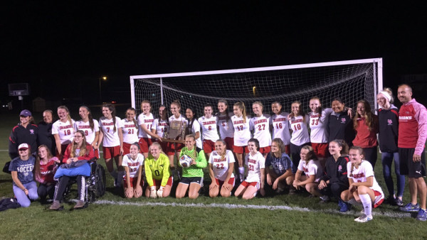 The Dragon girls soccer team celebrates its 12th sectional title since 2000.
