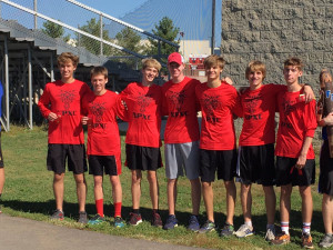 The Dragon boys cross country team celebrates its second-place finish in sectional.