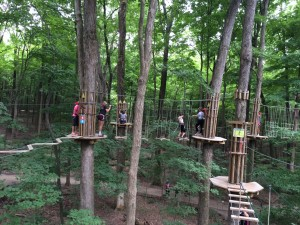 Warrior volleyball players in the trees at Go Ape in Indianapolis