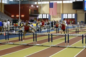 Kiara Williams and Madison Kirkwood compete in the 60m hurdles.