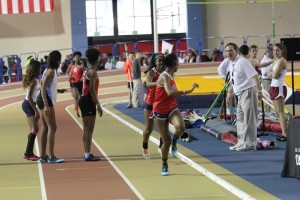 Kiara Williams passing the baton to Christian Hill in the 4x200m.