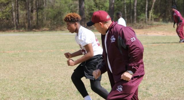 MLK Football Staff & Players @ the DYJ Community Day