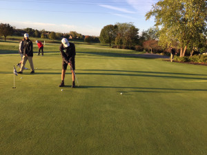 Cole on the putting green.