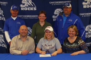 Megan Finkbeiner is all smiles on signing day as she is surrounded by family and the Rocks' coaches.
