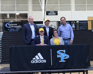 Thomas Jordan, with his parents, Head Football Coach Shawn Raney and Head Track and Field Coach Michael Zelwak