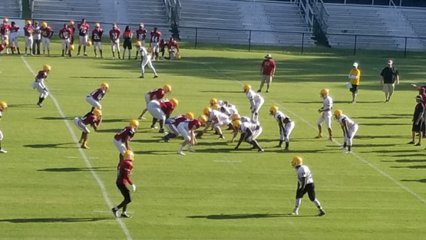 The Panther offense, in White, scrimmages the Panther defense, in Garnet.