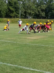 Dylan Beauford boots an extra point attempt during Summer Practice.