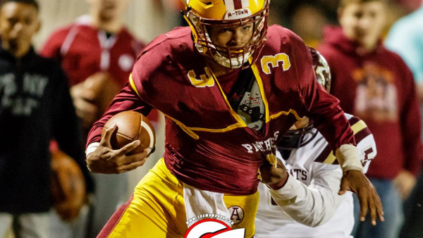 B. Jackson runs through a tackle. Pic by Shawn Knox Images