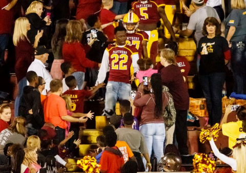 The Panthers make their entrance, through the crowd at Hite Stadium. Pic by Shawn Knox Images.