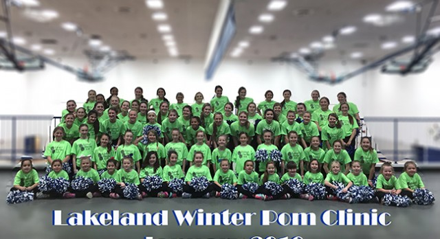 Pom clinic attendees perform at basketball game