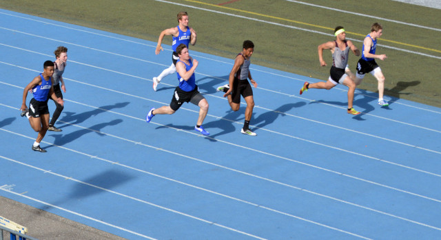 Boys track team loses close meet to Walled Lake Northern
