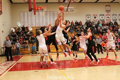 Perry High School Boys Varsity Basketball falls to Ionia High School 53-44