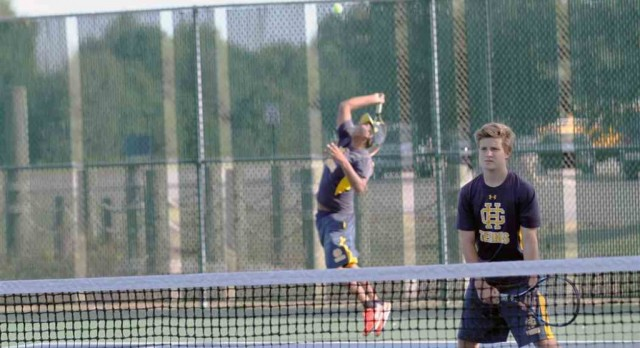 Grand Haven High School Boys Varsity Tennis ties West Ottawa High School 4-4