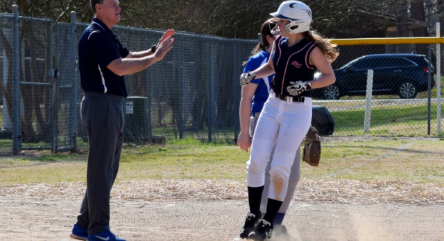 Lions Softball Overwhelms Christ the King