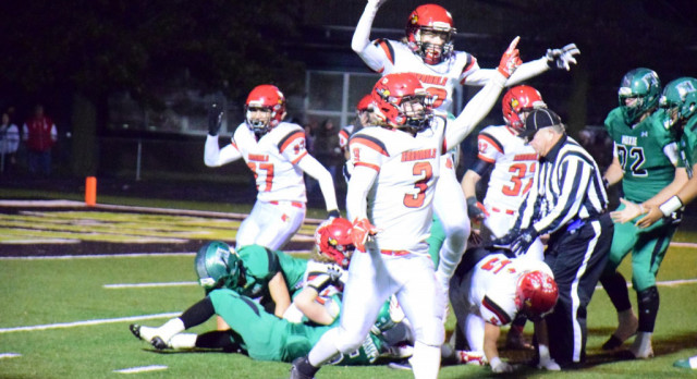 Cards hold on for 2nd playoff win in school history