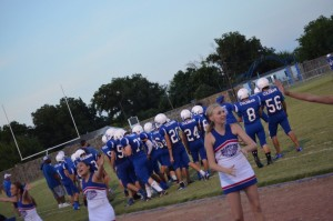 cheerleaders and team