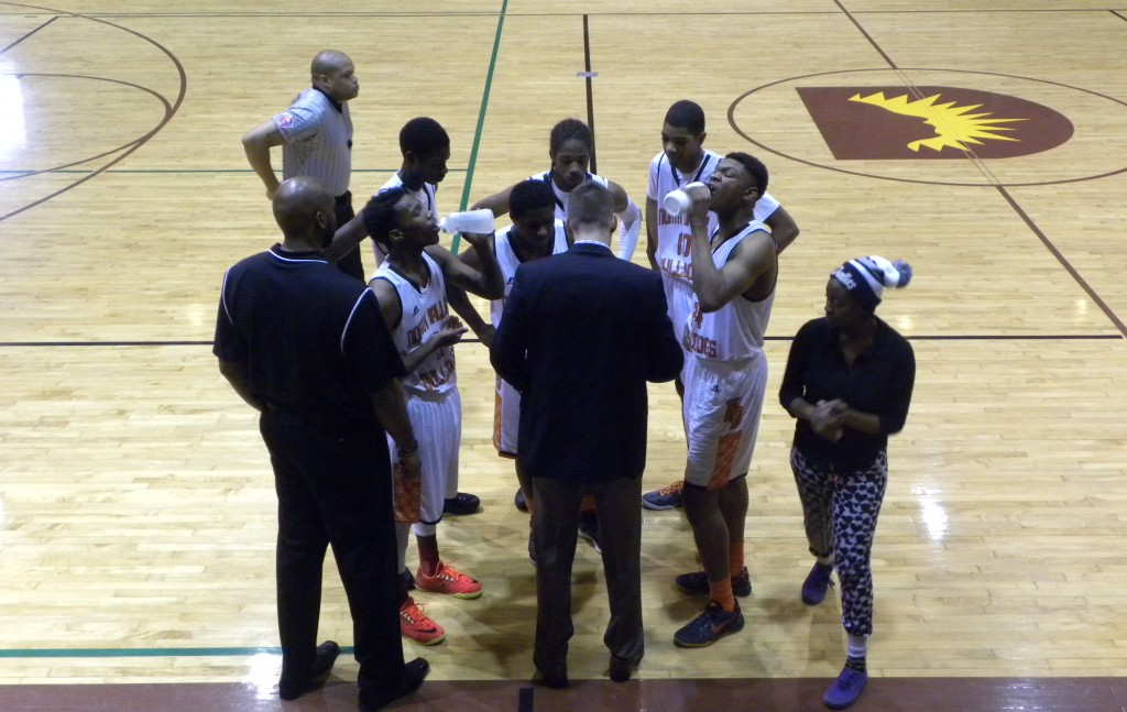 North Dallas High Coach Brett Cole talks to his team during a timeout against Carrollton Creekview in a District 11-5A opener on Jan. 3 at Cobb Field House.
