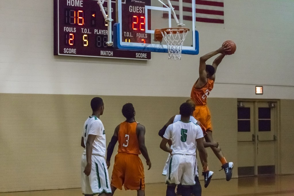 North Dallas' Kobe Wrice goes up for a dunk.