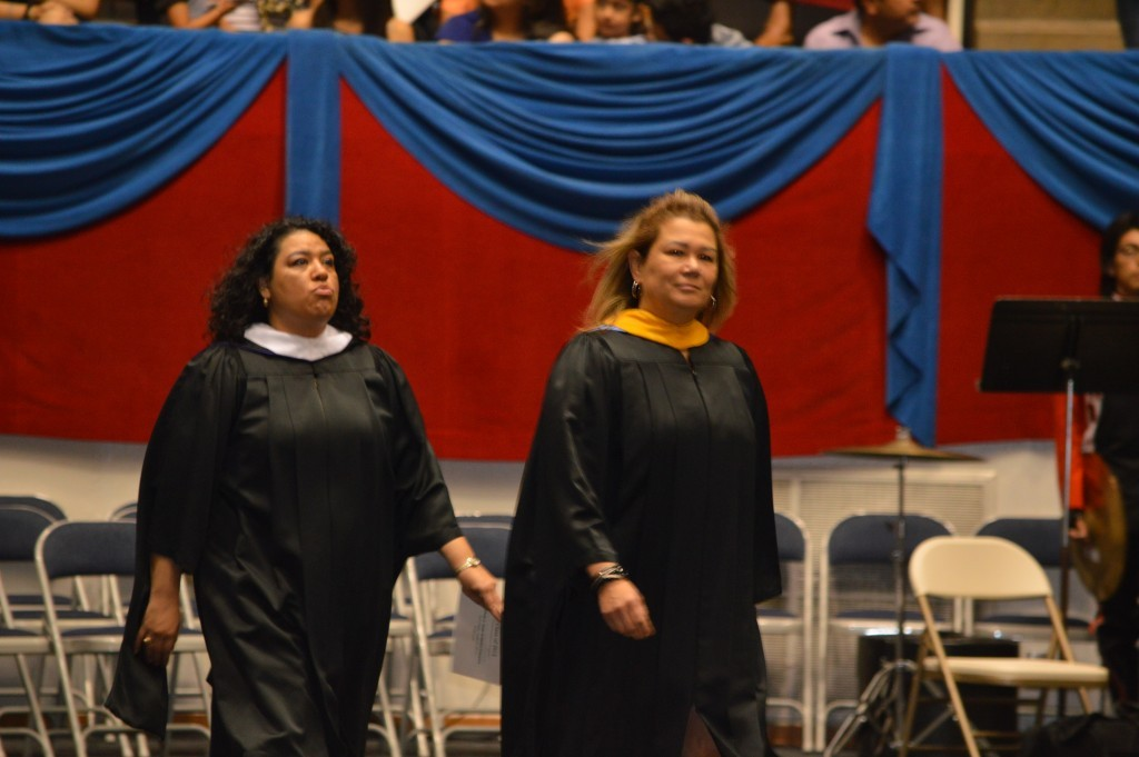 History teacher Christina Herrera and Principal Patty Rodriguez enter the area for graduation in June.