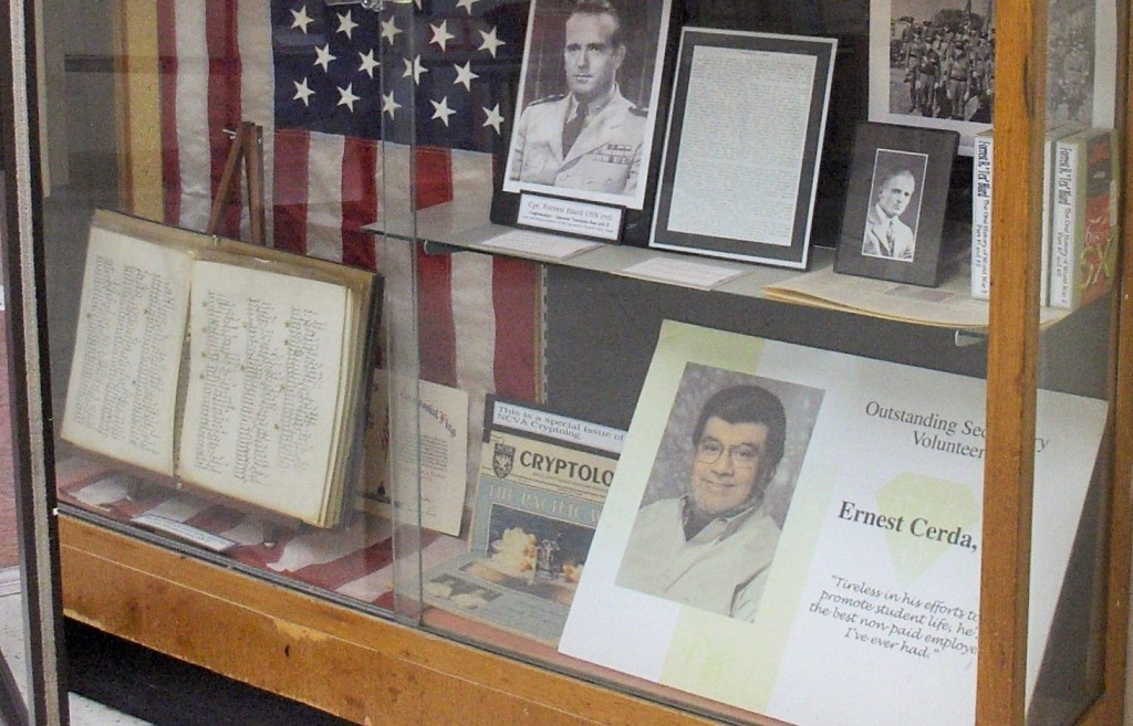 Ernest Cerda's Volunteer of the Year in 2003 award is displayed in a school trophy case. (Photo by Danny Linn)
