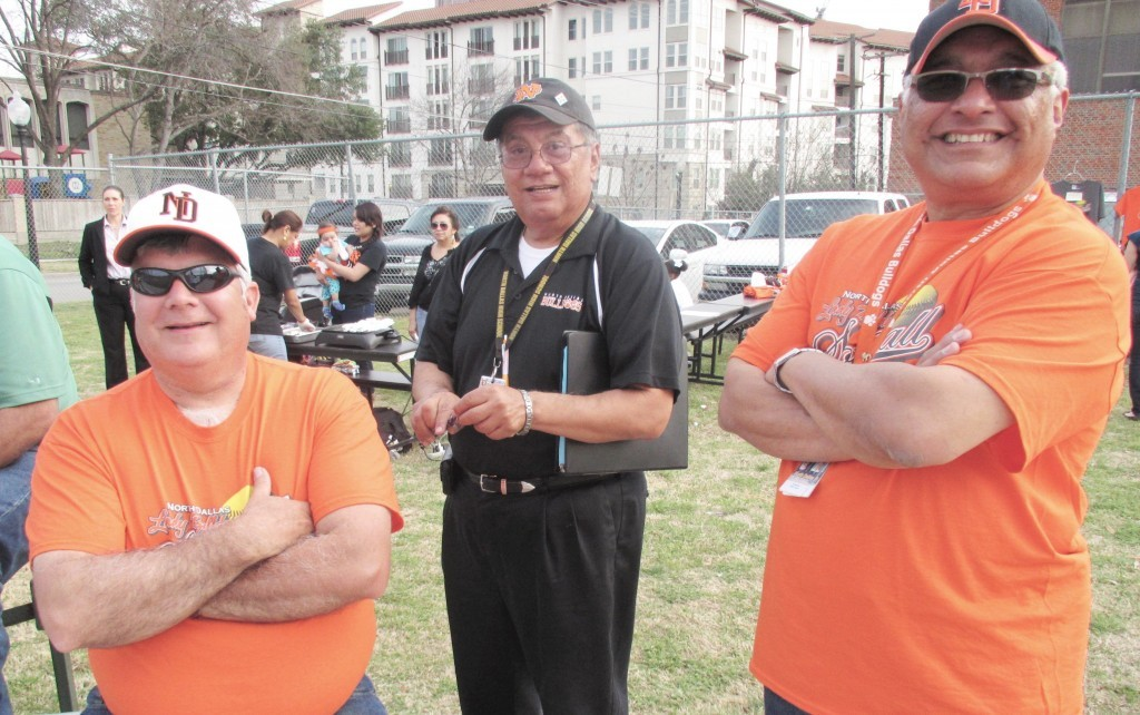 Ernest Cerda, who started the ND Booster Club, visits with current officers  President Greg Kimber (left) and vice president Gil Sandoval (right). (Photo by Danny Linn)