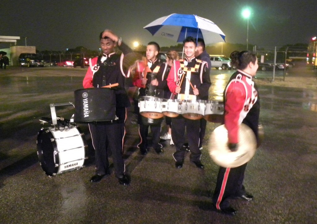 Band members head toward the field after the first delay Thursday night at Couch Field.