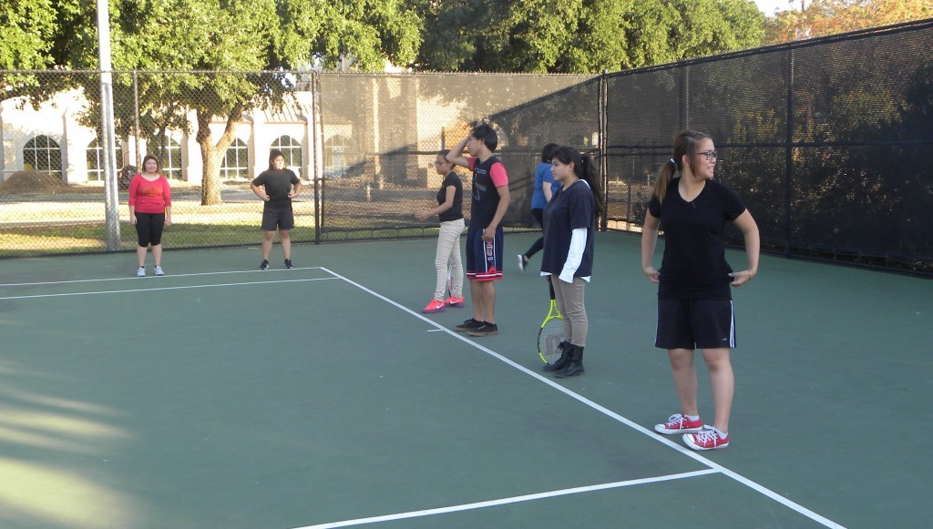 Team members, including Zayra Chab (from left), Noemi Padron, Noemi Matus, Mario Almaguer, Angel Bazan and Anna Nguyen, line up to do foot drills.