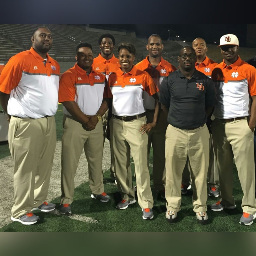 "Coach Desiree´Allen with the North Dallas football coaches, her ""band of brothers."""
