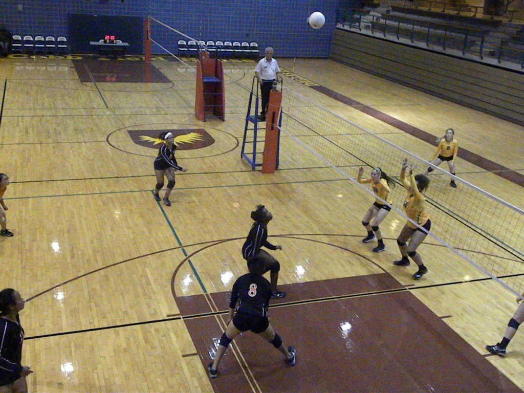 Shakira Peck and Kaitlyn Contreras converge on the ball.