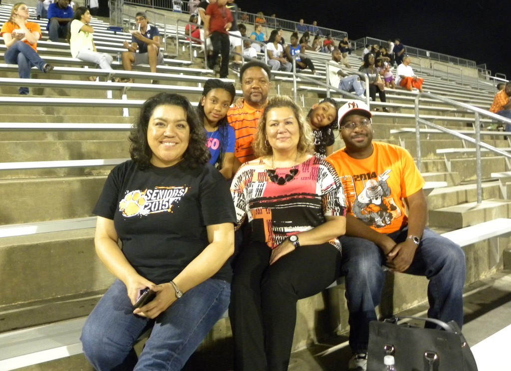 Christina Herrera, ND Principal Patty Rodriguez and Johnathan Gipson, along with Mr. Whitaker and his daughters, were at Friday's game at Kincaide Stadium.