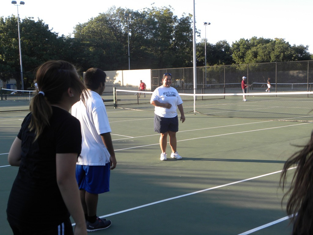 Tennis Coach Lisa Buitron-Irani leads the team through drills.